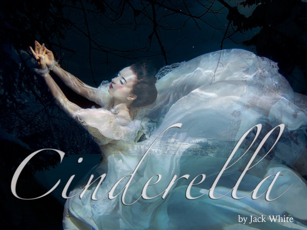 young girl in long white dress underwater